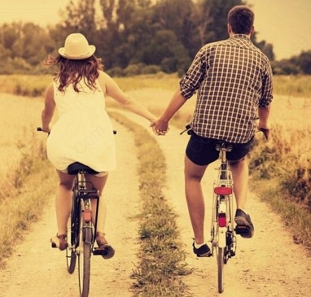 Couple-riding-bike